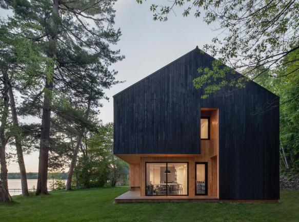 Деревянный дом на озере по проекту Atelier Schwimmer